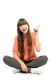 Menina que aponta o dedo Foto de Stock