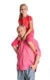Menina que aprecia às cavalitas o passeio com seu avô Imagens de Stock