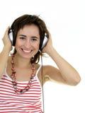 Menina que aprecia a música fotografia de stock