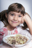 Menina que aprecia seu almoço Fotografia de Stock Royalty Free