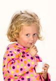 Menina que bebe através de uma palha imagens de stock royalty free