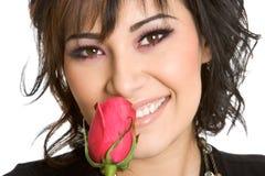 Menina que cheira Rosa Fotos de Stock