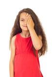 Menina que cobre um olho Foto de Stock Royalty Free