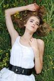 Menina que coloca no prado Imagens de Stock