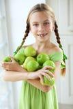 Menina que come maçãs Imagens de Stock Royalty Free