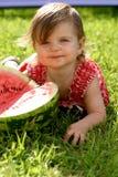 Menina que come a melancia Foto de Stock Royalty Free