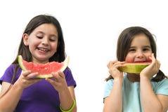 Menina que come a melancia Fotografia de Stock
