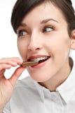 Menina que come o chocolate Foto de Stock Royalty Free