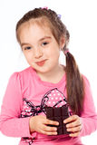 Menina que come o chocolate Fotografia de Stock