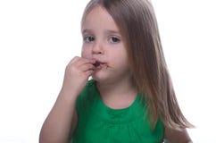 Menina que come o chocolate Imagens de Stock