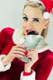 Menina que come o chocolate do Natal Imagem de Stock Royalty Free