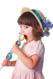 Menina que come o lollipop Imagens de Stock Royalty Free