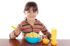 Menina que come o pequeno almoço Imagem de Stock Royalty Free