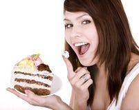 Menina que come a parte de bolo. fotografia de stock royalty free