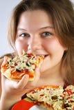 Menina que come a pizza Fotos de Stock Royalty Free
