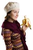 Menina que come uma banana Fotos de Stock Royalty Free