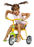 Menina que conduz a bicicleta fotografia de stock royalty free