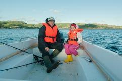 Menina que conduz o barco a motor Imagem de Stock