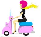 Menina que conduz um 'trotinette' Foto de Stock