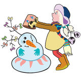 Menina que constrói um boneco de neve Foto de Stock