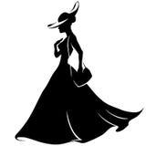 Menina que corre em um chapéu e em um vestido com bolsa Fotografia de Stock Royalty Free