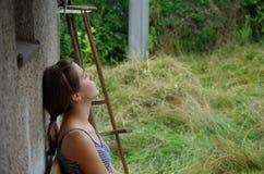 Menina que descansa após o trabalho Imagem de Stock