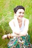 Menina que descansa na grama fresca da mola Fotografia de Stock Royalty Free