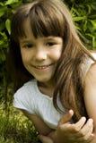 Menina que descansa no prado Imagem de Stock