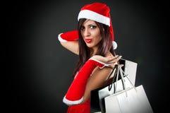 Menina que desgasta a roupa de Papai Noel Fotos de Stock Royalty Free