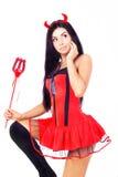 Menina que desgasta um traje de Halloween de um imp Imagens de Stock