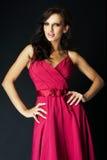 Menina que desgasta um vestido agradável do sibilo Imagens de Stock Royalty Free