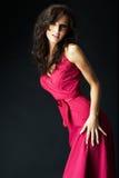 Menina que desgasta um vestido agradável do sibilo Imagem de Stock