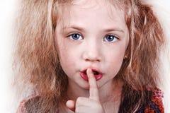 Menina que diz manter o silêncio Foto de Stock Royalty Free