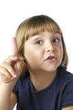 Menina que diz um segredo Foto de Stock