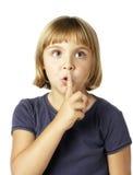 Menina que diz um segredo Imagens de Stock