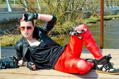 Menina que encontra-se na doca Imagem de Stock Royalty Free