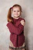 Menina que engana no estúdio Fotografia de Stock Royalty Free