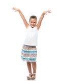 a menina que está no contexto branco levantou suas mãos acima fotografia de stock