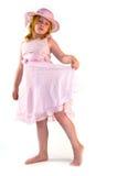 Menina que está no vestido cor-de-rosa imagens de stock royalty free