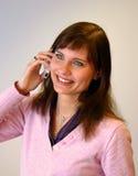 Menina que fala em seu telemóvel imagens de stock royalty free
