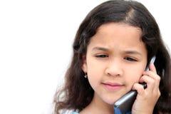 Menina que fala no telefone de pilha Fotografia de Stock
