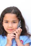 Menina que fala no telefone de pilha Imagens de Stock