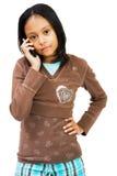 Menina que fala no telefone móvel Fotografia de Stock Royalty Free