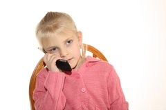 Menina que fala no telemóvel Imagem de Stock Royalty Free
