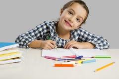 Menina que faz desenhos Foto de Stock Royalty Free