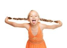 Menina que faz a face engraçada Imagens de Stock
