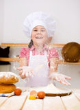 Menina que faz o pão Foto de Stock Royalty Free