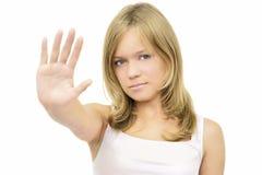 Menina que faz o sinal do batente fotos de stock