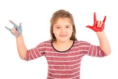Menina que faz o sinal do rock and roll Foto de Stock