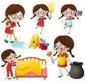 Menina que faz tarefas diferentes Fotos de Stock